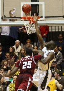Bona's Youssou Ndoye blocks UMass' Cady Lalanne in a battle of the beef this season.