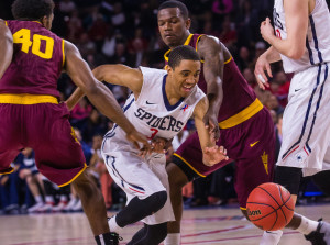 Richmond's ShawnDre' Jones splits two ASU defenders in the Spiders NIT win Sunday.