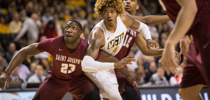 VCU's Justin Tillman battling for a rebound against Saint Joseph's Markell Lodge